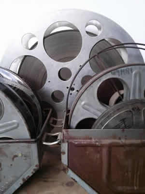Film Transfer 8mm Film Reels in Rusty Container